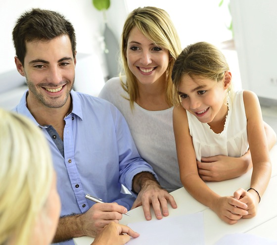 Young family discussing insurances