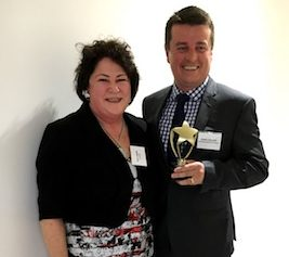 This photo of Daniel Bullock with Sheila Baker after being announced as the 2016 winner of the Valerie Baker Memorial Award