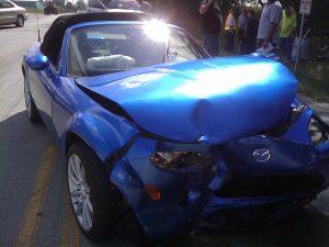 Blue crumpled car