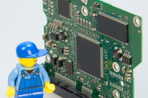 lego man with computer board
